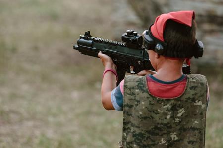 Kid aiming gun
