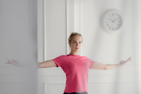 Sportswoman stretching at home