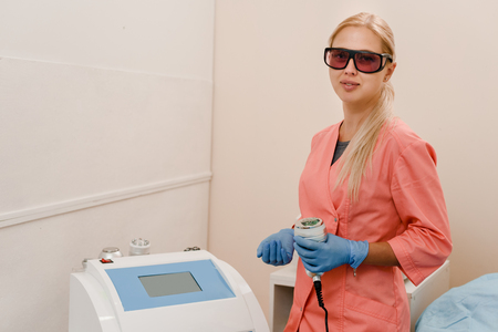 Doctor with laser machine Stock Photo