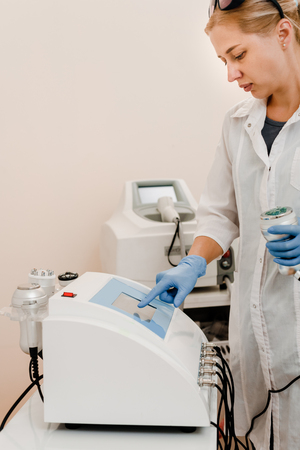 Professional cosmetologist with equipment Stock Photo