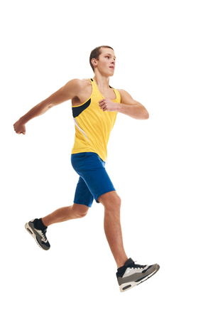 Full photo of healthy sporty man running on white background