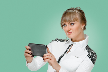 portrait of blonde business woman with device on background jungle shade green color Stock Photo - 120651994