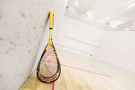 Dnepr, Ukraine- November 18, 2018: Closeup photo of squash rackets on empty squash court