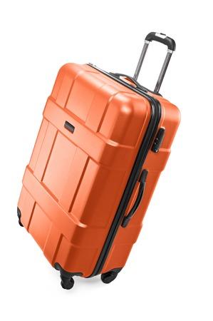 Big orange plastic luggage bag with wheels for travel Stock Photo