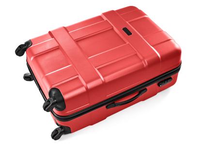 Large plastic red suitcase on wheels for traveler luggage Stock Photo
