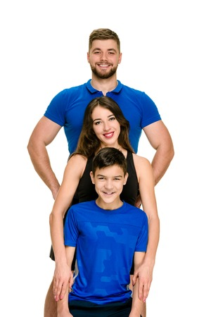 Portrait of smiling healthy parents with son doing sports Stok Fotoğraf