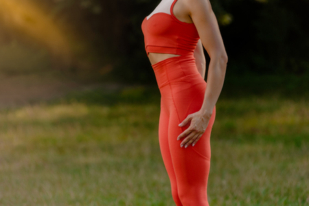 Closeup of sporty woman with slim fit healthy body in park Stok Fotoğraf