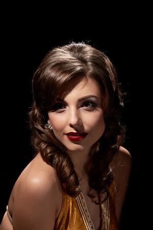 Beautiful glamour smiling woman posing on black background