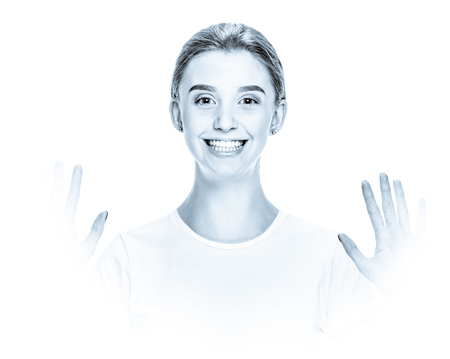 Happy cheerful excited girl showing two palms, black and white image in high key style with blue toning and soft vignetting Reklamní fotografie