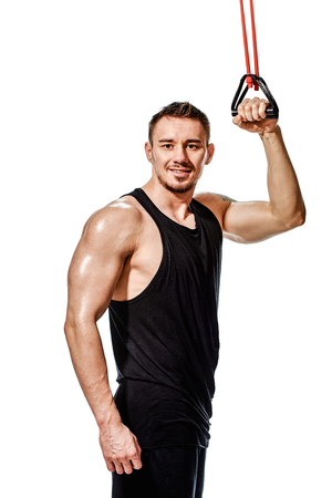 Portrait of happy handsome bodybuilder training with elastic expander