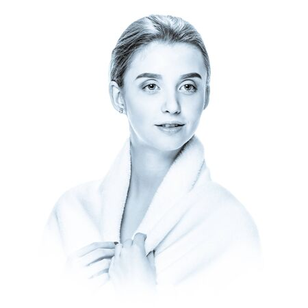 Portrait of pretty girl wearing bathrobe after spa procedures, black and white image in high key style with blue toning and soft vignetting