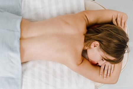 Top view of relaxed woman after massage in spa salon 写真素材 - 124983965