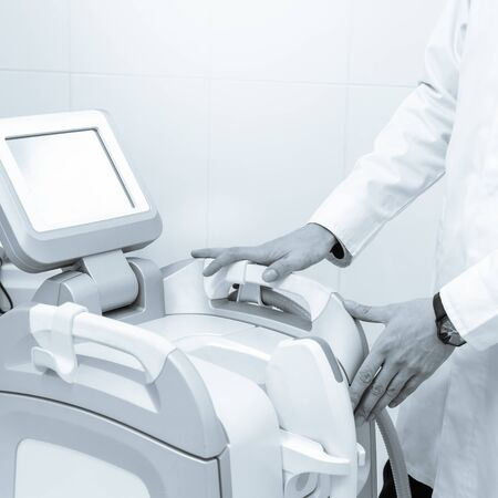 Modern Harmony XL apparatus for vitiligo and couperose treatment black white image with a blue toning