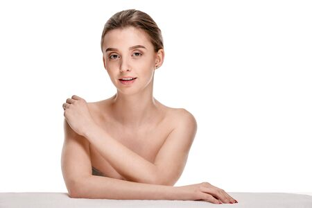 Portrait of attractive woman touching shoulder Stock Photo