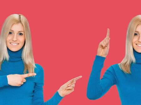 attractive young blonde woman pointing her finger on background indian shade red Stock Photo