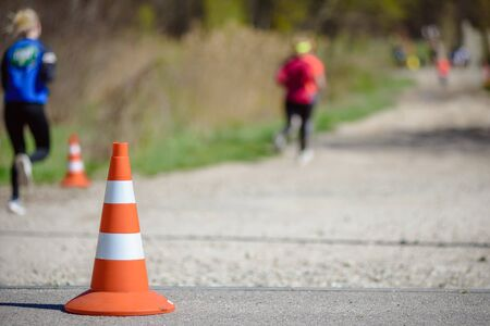 Amateur athletes running on track during marathon, closeup photo