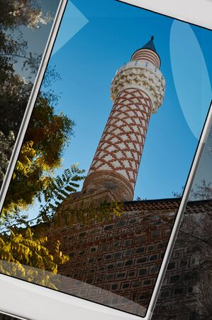 Smartphone displaying photo of minaret of a mosque in Plovdiv, Bulgaria, concept of new features in smartphone s camera