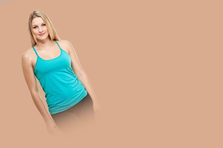 fitness woman. Young sporty Caucasian female model isolated on background salmon shade red