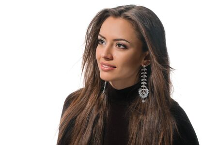 Glamour portrait of young attractive brunette wearing earrings