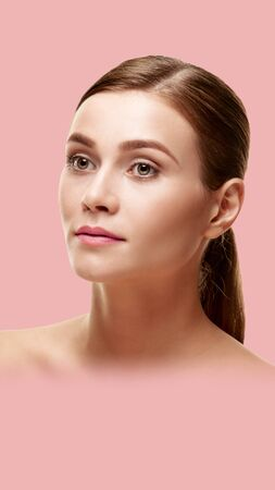 Beautiful woman with healthy face skin on pink background. Aspect ratio and vertical position convenient for placement on a smartphone