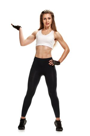Full photo of slim athletic woman showing hand in glove