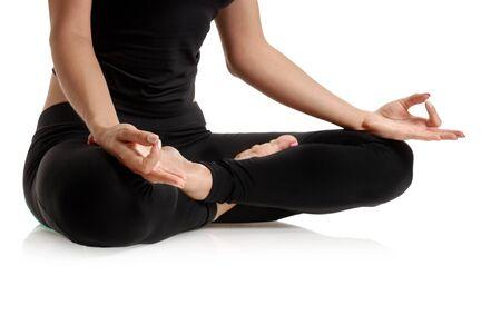 Closeup photo of yoga woman meditating in lotus pose
