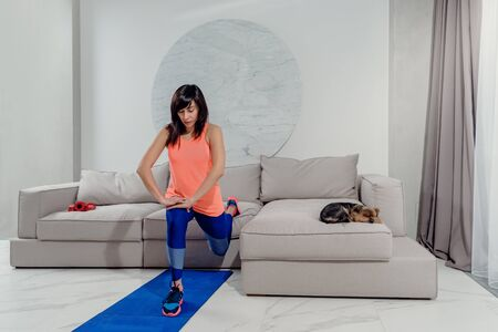 Portrait of slim attractive healthy woman practicing yoga at home