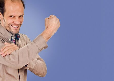 young man showing cubital sign. Synonym sign of middle finger. on blue color background