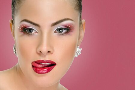 Sexy woman with red lips on background punch shade pink