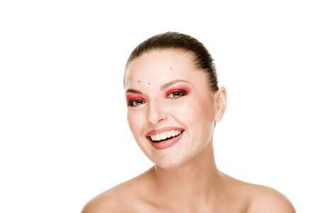 Portrait of cheerful laughing woman with bright makeup and diamonds on face Stock Photo