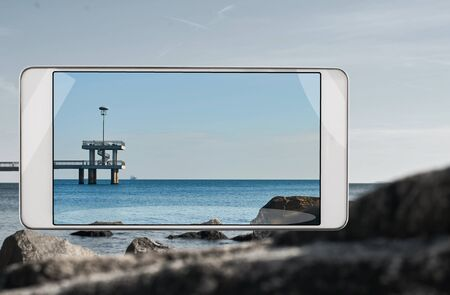 Smartphone displaying photo of bridge in Burgas city, concept of new features in smartphone s camera. Original items have been removed from the front panel Stok Fotoğraf