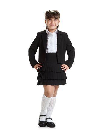 Portrait of smart confident girl in school uniform posing on white background