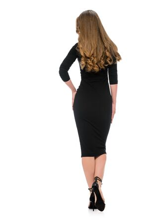 Back view of woman in black dress showing her slender perfect figure