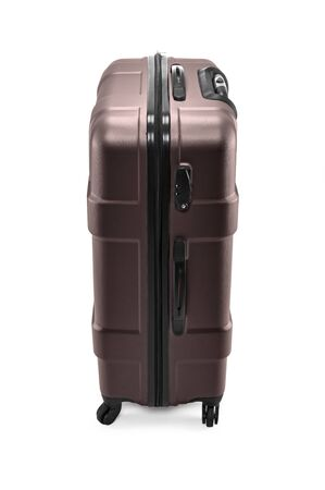 Modern plastic brown suitcase on wheels for business trips Banco de Imagens