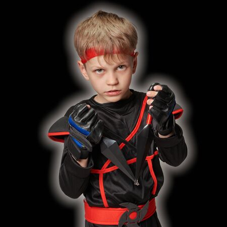 Portrait of mysterious ninja boy on black background with lightning aureole