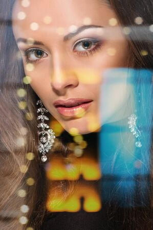 elegant fashionable woman with ear ring. portrait, double multiple exposure effect,combined images
