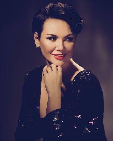 Elegant stylish hollywood woman in expensive black dress. retro style toned image