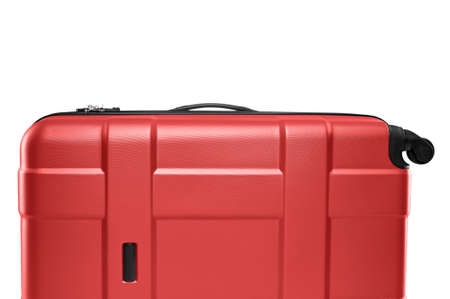 Fragment of red plastic valise on wheels isolated on white background