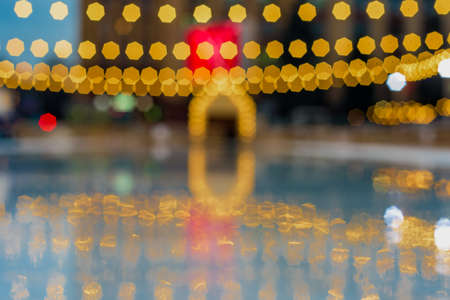 Blurred view of night ice rink with bokeh effect Фото со стока