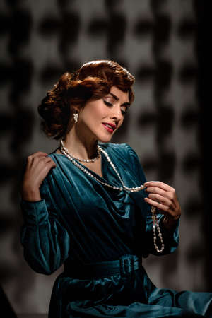 Gorgeous smiling lady in vintage dress and necklace