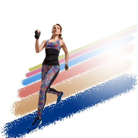 Young healthy strong woman running on a white background with colorful stripes 写真素材