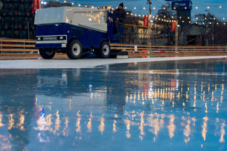 Dnepr, Ukraine- December 24, 2019: Modern ice resurfacer preparing ice on rink for skating