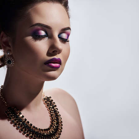 Portrait of young attractive glamour woman wearing luxury necklace and earrings