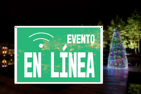 sign EVENT PARTY ONLINE with the inscription in spanish, New Year party canceled due to coronavirus quarantine, precautions during a pandemic, combating covid virus, social distancing.