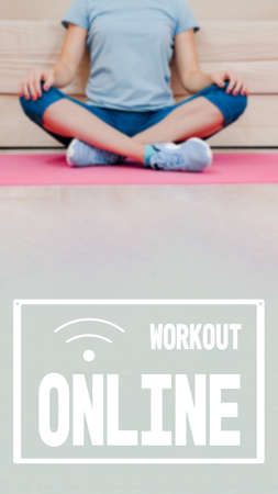 Concentrated attractive woman practicing yoga while stay home for quarantine, online training, virtual trainer, image with text workout online and oriented for use on a smartphone. 写真素材
