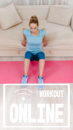 Healthy athletic girl using sofa while doing training at home, image with text workout online and oriented for use on a smartphone. 写真素材