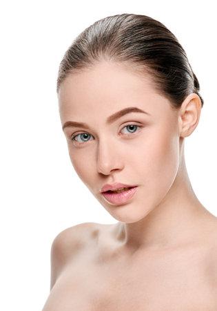 Beautiful young woman with fresh healthy facial skin