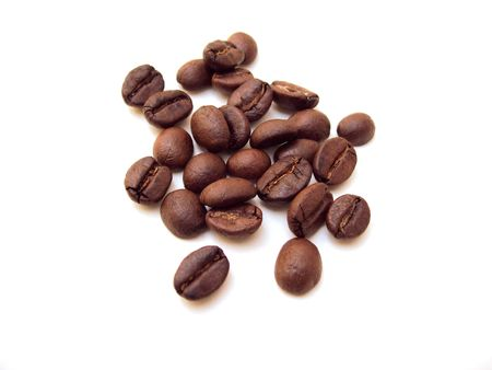A pile of coffee beans shot on a white background.