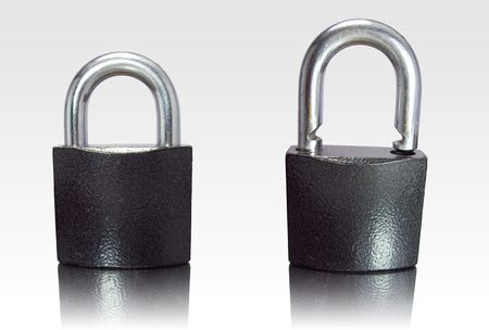 Padlock isolated on white with - reflection. Stock Photo