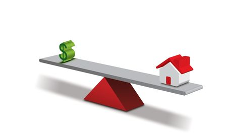 Seesaw concept Dollar and a House Stock Photo